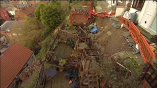 The gardens of these houses collapsed amidst the extreme weather