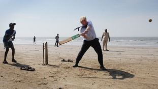 London's Mayor plays cricket with local Mumbai school boys on Juhu Beach.