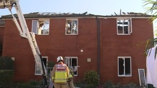 Firefighters survey the damage