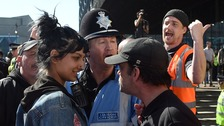 The image of Saffiyah Khan (left) staring down an EDL activist has been shared widely on social media
