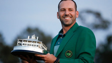 Sergio Garcia, of Spain, holds his trophy at the green jacket ceremony.