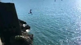 A teenager is filmed jumping into the sea from the notorious cliff edge