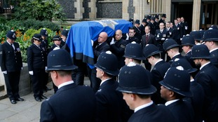 Pall bearers carry the coffin of Pc Keith Palmer out of Southwark Cathedral.