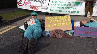 Anti-fracking protesters chain themselves up outside lorry depot