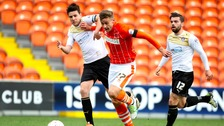 Owen Garvan (left) in action for Colchester United last season.
