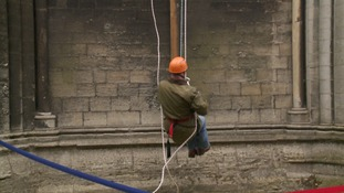 A bishop abseil's down Peterborough Cathedral in 2016.