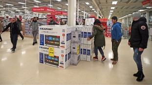 Tesco's profits took a hit because of a £129 million fine.