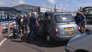 Passengers getting in to a taxi