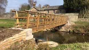 The new footbridge goes over Lyvennet Beck in Maulds Meaburn village