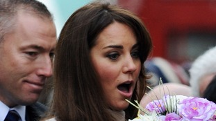 The Duchess of Cambridge reacts as she is handed a bouquet of flowers outside Senate House, University of Cambridge.