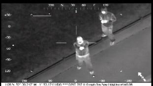 CCTV suspect aiming gun