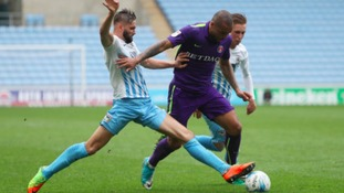 Coventry City's Jordan Turnbull and Charlton Athletic's Josh Magennis battle for the ball