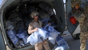 Camp Bastion troops unload Christmas mail from the UK, as well-wishers are urged to stop sending Christmas presents.