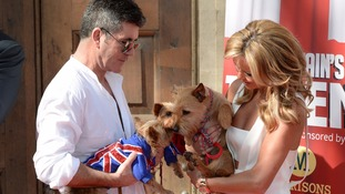 Simon Cowell's dogs say hello to Amanda Holden's