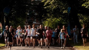 Runners take part in parkrun.