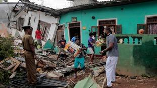 Massive mound of rubbish crushes 22 people in Sri Lanka