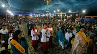 Pakistani Christians attend an early morning Easter service at St. Patrick church in Karachi.