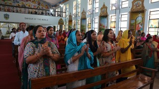 Indian Christian devotees offer prayers at a church.