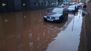 The burst pipe caused damage to the road