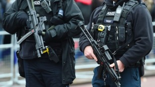 Armed police responded after the man was seen walking through the airport with a fake rifle