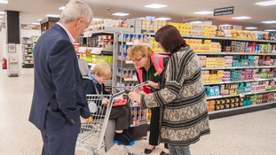 Jayden Renouf tries out the new shopping trolleys for children with special needs.