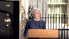Theresa May making the announcement outside 10 Downing Street.