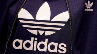 The logo of German sports equipment company Adidas.