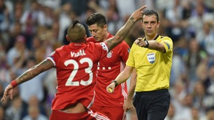 Vidal remonstrates to the referee