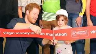 Prince Harry gets a little help opening London Marathon from five-year-old girl