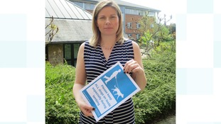 Emma Wild from Wychavon holding one of the posters.