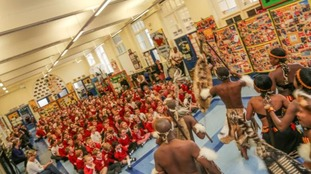 The Lions perform for school children