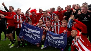 Open-top bus parade for Sheffield United's promotion heroes