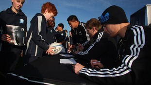 The All Black sign autographs