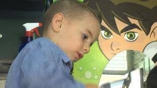 Boy, 4, cuts a dash as trainee barber