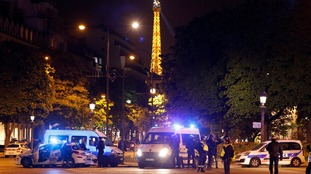 The shooting near the Eiffel Tower saw a police officer killed along with an attacker.