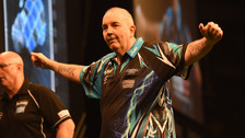 Phil Taylor salutes the crowd in his final competitive appearance in Belfast.