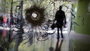 A bullet hole after the attack.