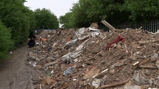 It will cost an estimated £60,000 to clear this site of illegally dumped rubbish in east London.