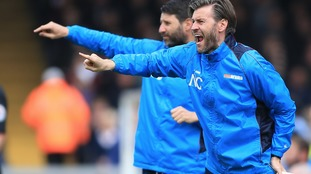 Lincoln City's Danny (left) and Nicky Cowley gesture on the touchline against Macclesfield Town