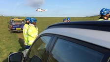Paraglider airlifted to hospital after crashing into cliffs