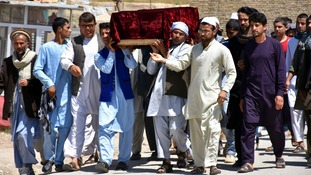 Coffins of victims were carried after a bomb and gun attack that claimed more than 100 lives.