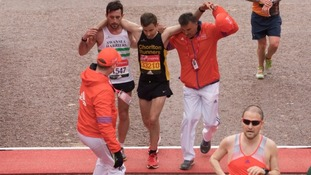 Matthew Lees, left, helps the exhausted runner
