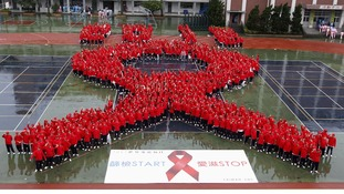 Students form a giant red ribbon in Taipei.