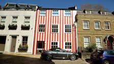 Woman wins court battle to keep her candy striped house