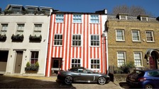 Woman wins High Court battle to keep candy striped house