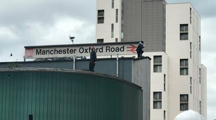 City centre disruption as pair stage protest on roof of busy railway station