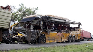 At least 27 people killed as bus hits lorry travelling in opposite direction
