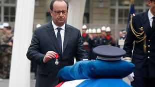 Slain officer's partner appeals for peace as France honours Champs-Elysees attack victim