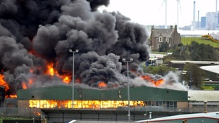 Investigations continue into major fire at Maryport warehouse