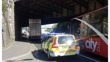 Trains suspended as lorry gets stuck under bridge